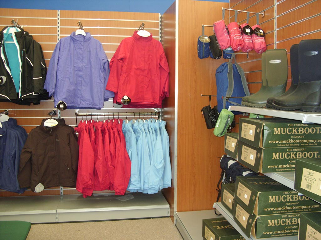 Retail shop shelving with slatwall and garment displays